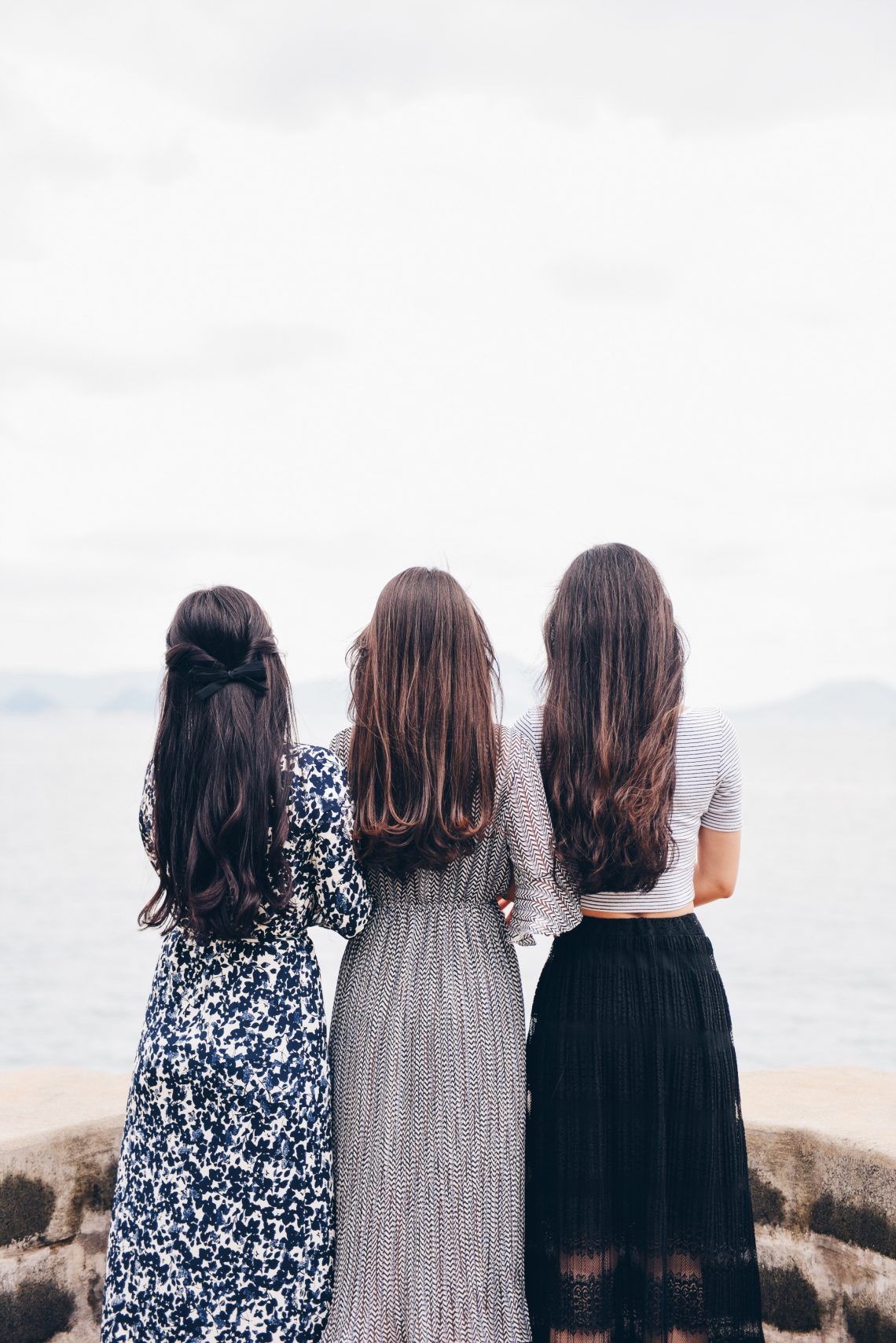 Three women looking at the ocean