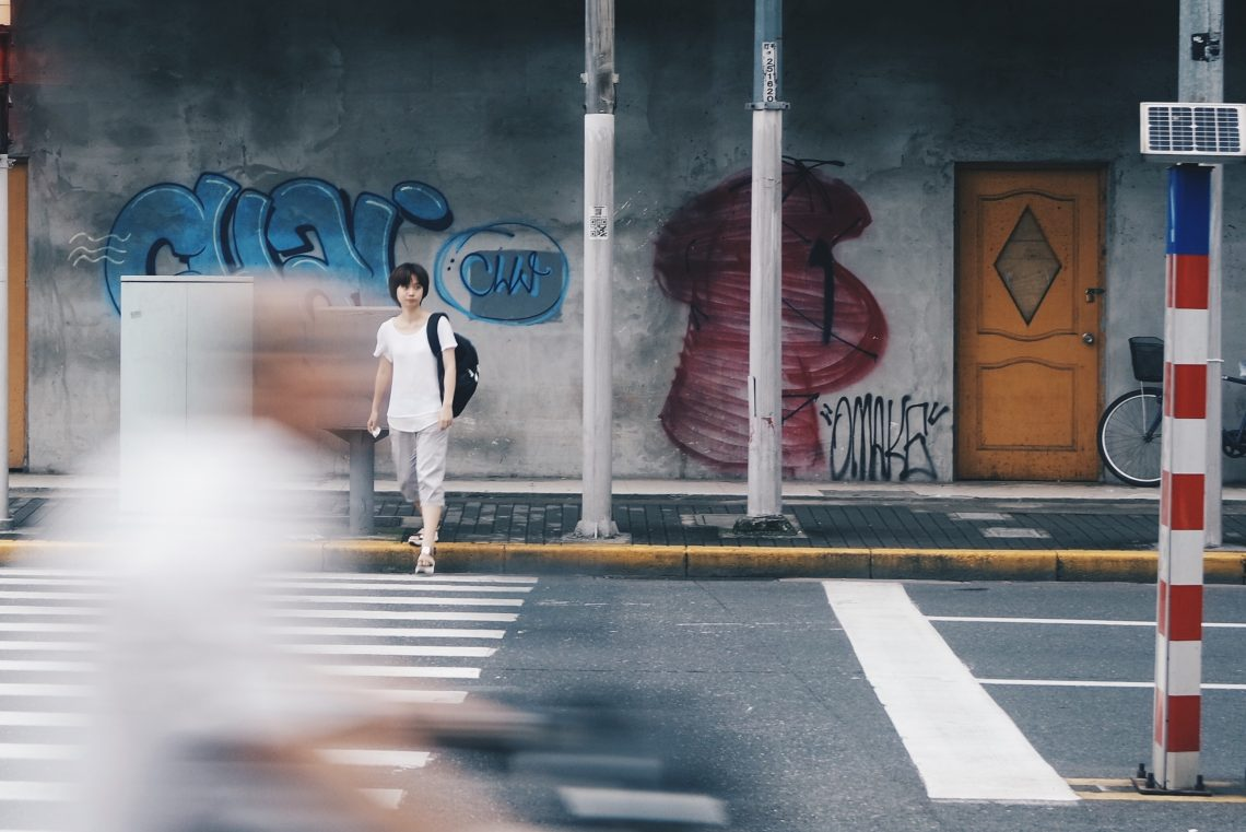 Woman crossing street