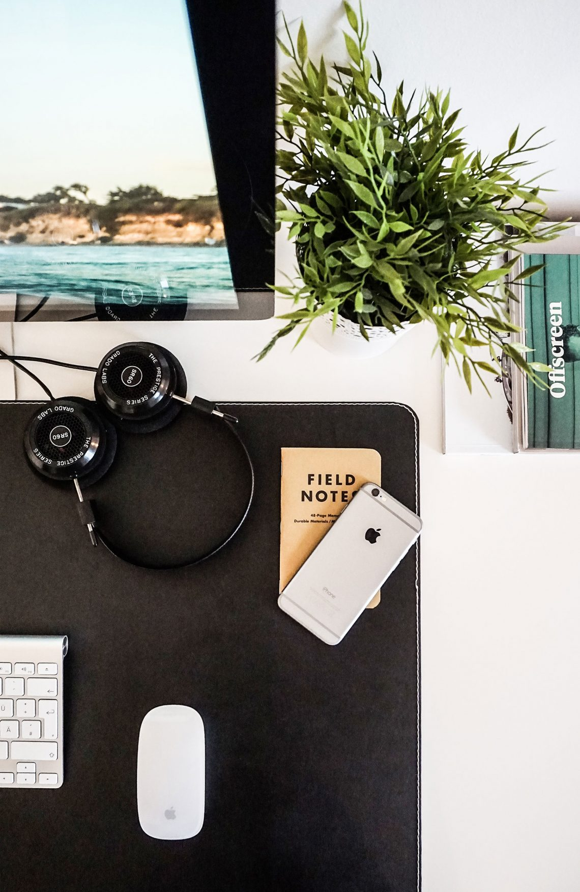 Field notes and head phones on desk